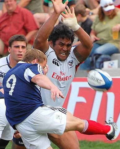 opponent attempts to charge down a box kick by the scrum half