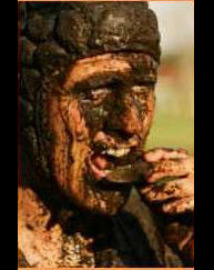 rugby players face caked in mud